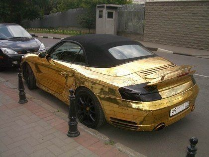 Шик по-русски: Porsche 911, покрытый золотыми пластинами - фото 10