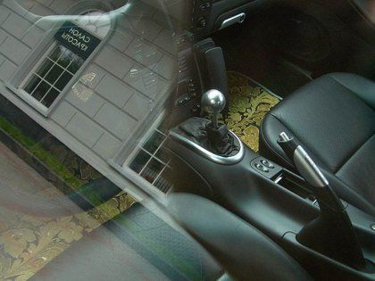 Шик по-русски: Porsche 911, покрытый золотыми пластинами - фото 2