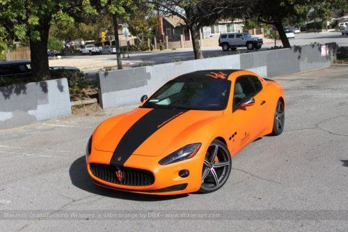 Maserati GranTurismo S затянули в оранжевую пленку в DBX - фото 18